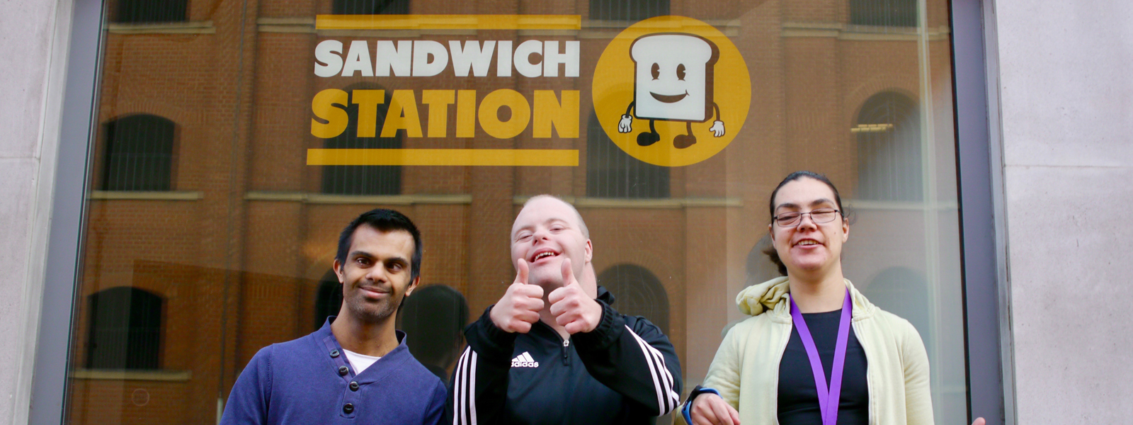 People with learning disabilities standing outside a sandwich shop