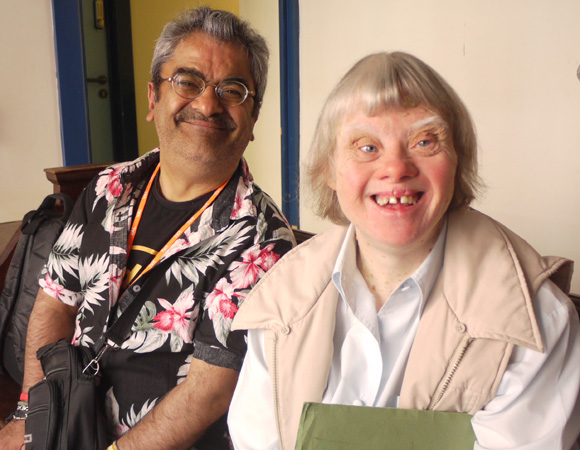 Two VALUES clients with learning disabilities sitting on a sofa and smiling