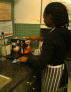A person with learning disabilities working in a kitchen